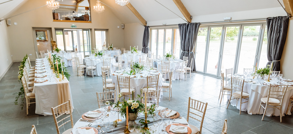Guests enjoy a delicious wedding breakfast in the Orchard Barn expertly prepared by the exclusive caterers Galloping Gourmet