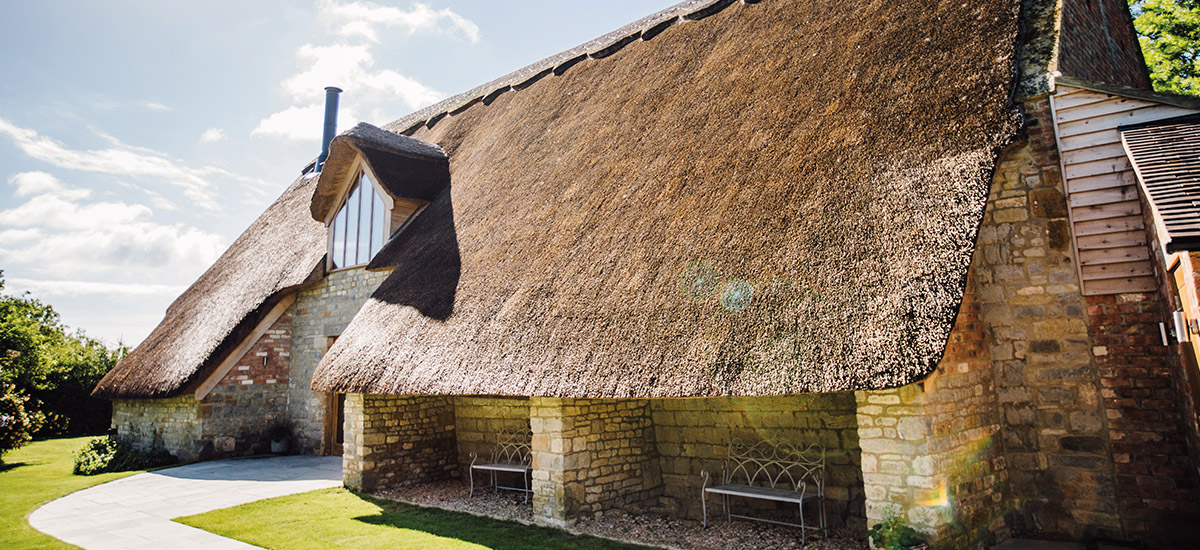 The exquisite Thatch Barn with exposed brick and exposed beams is a romantic space to say I do